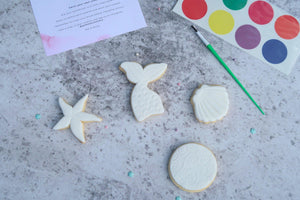 mermaid tail cookie, shell and star fish cookie, round cookie with swirls