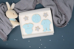 It's a boy cookie set, grey stars, blue vest and blue baby grow