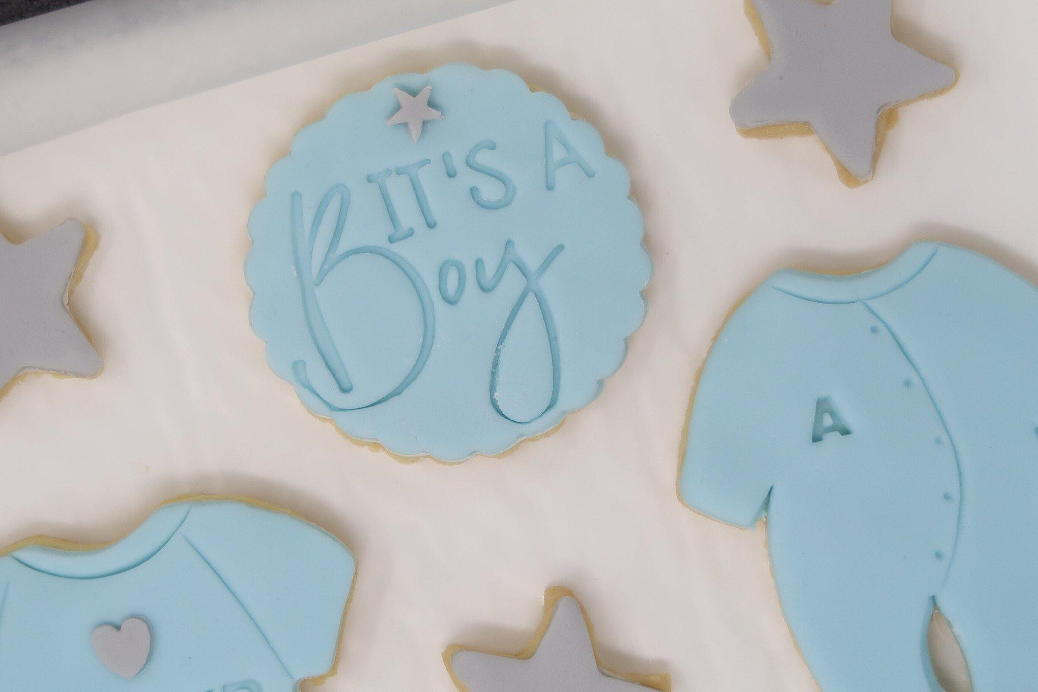 It's a boy cookies set in blue and grey