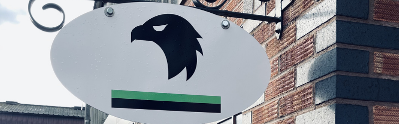 Motohawk's logo on an oval sign at their premises on Herbery Courtyard, Blackminster Business Park in Evesham.
