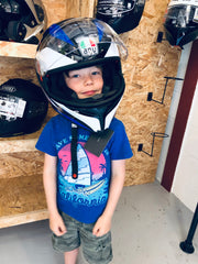 James' son trying on an AGV helmet for size - a biker in the making!