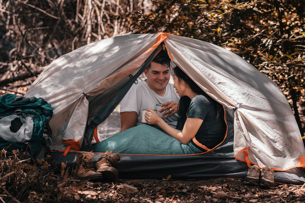 2 person lightweight tent with hiking boots and backpack
