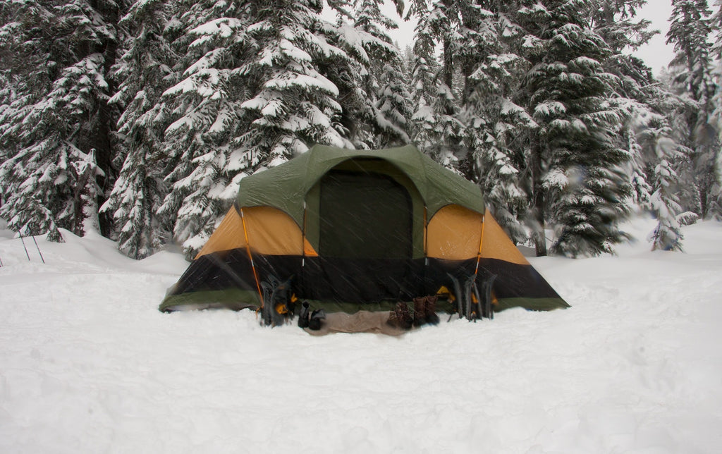 winter camping tent camp in the snow