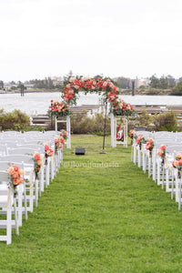 Wedding arch arrangement and aisle florals grace the wedding chairs and arch for the ceremony. We deliver flowers all over San Diego County.