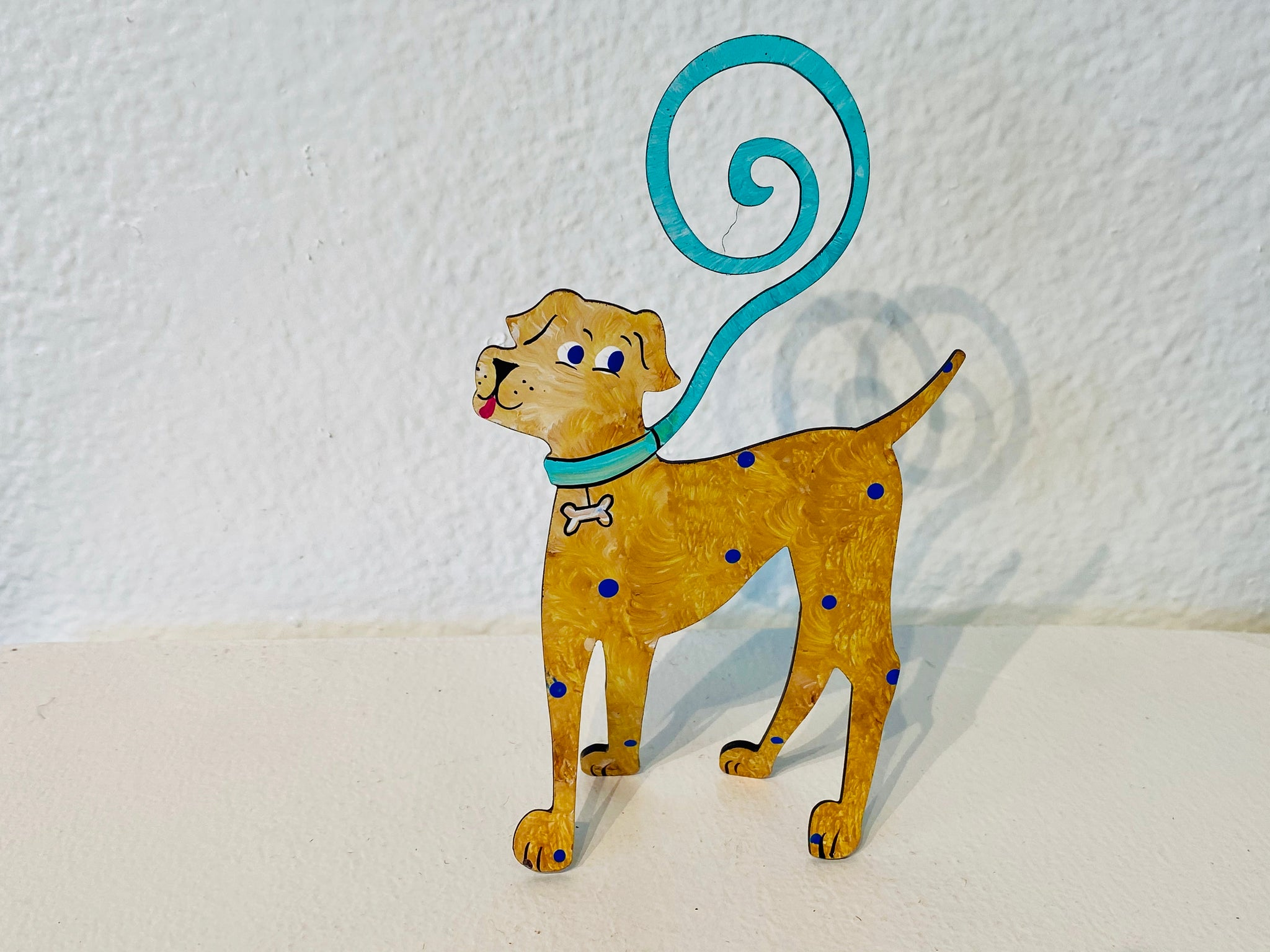 This whimsical and fun piece is hand made by an artist and fits in any part of your home to make the space a bit more fun!