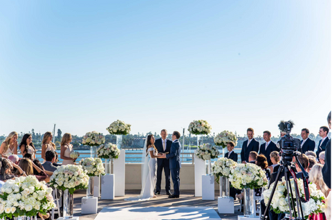 An example of a San Diego wedding with flowers lining the aisles. Arrangements doubled for the celebration after the ceremony.  We deliver flowers anywhere in San Diego.