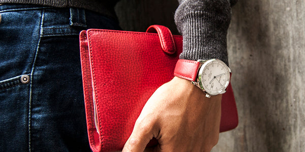 Fears Redcliff White on wrist with Filofax
