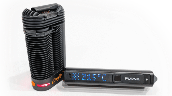 Crafty and Furna dry herb vaporizers side by side with power turned on.