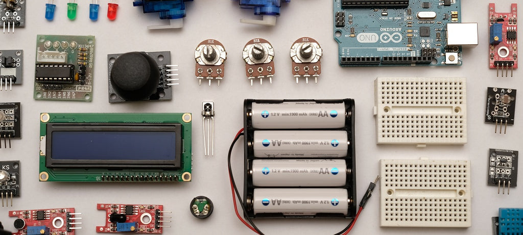 Various components and electronic parts laid out on a table.