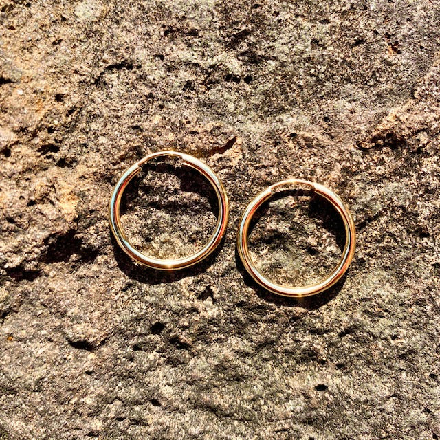 10k Yellow Gold Small Hoop Huggie Earrings sold in British Columbia, Canada by Crystal Cabin.