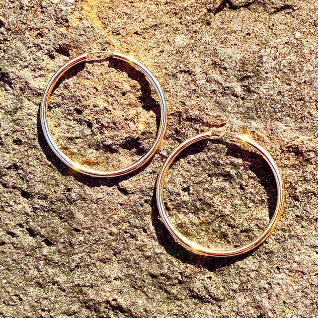 10k Yellow Gold Large Hoop Huggie Hollow Earrings. Sold in British Columbia, Canada by Crystal Cabin.