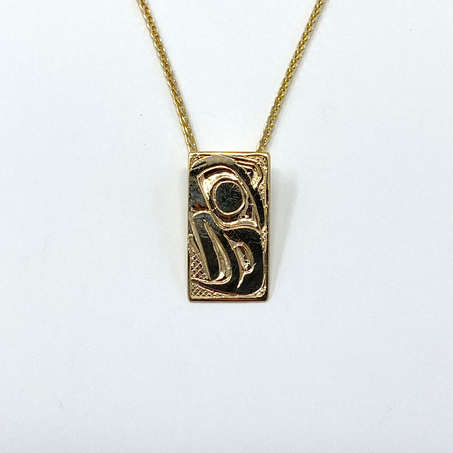 14K Yellow Gold Hand Engraved Eagle Necklace Pendant by Haida Indigenous Northwest Coast Native Artist Carmen Goertzen sold by Crystal Cabin