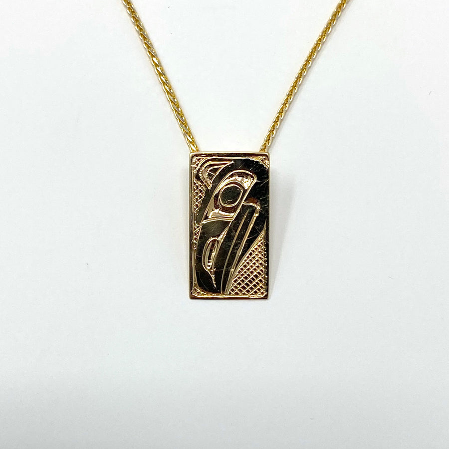 14K Yellow Gold Hand Engraved Raven Necklace Pendant by Haida Indigenous Northwest Coast Native Artist Carmen Goertzen sold by Crystal Cabin.