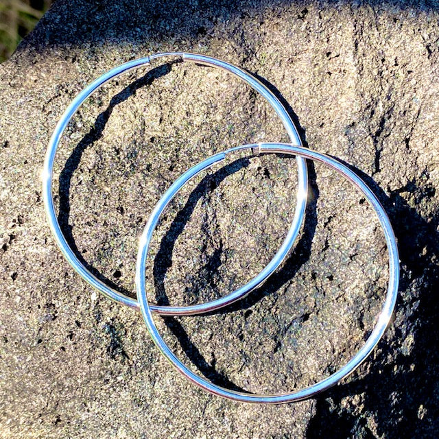 Sterling Silver Hoop Huggie Sleeper Earrings sold in British Columbia, Canada by Crystal Cabin.