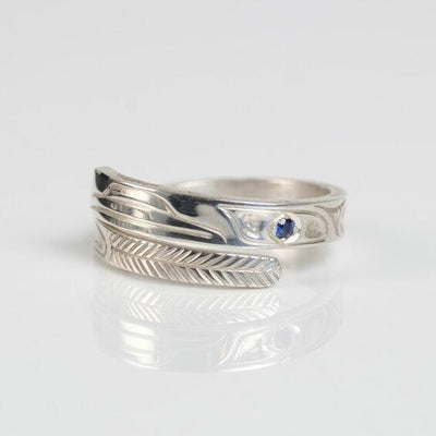 Silver & Sapphire Haida Raven Wrap Ring by Haida Indigenous First Nations Native artist Carmen Goertzen sold by Crystal Cabin in Haida Gwaii, British Columbia, Canada