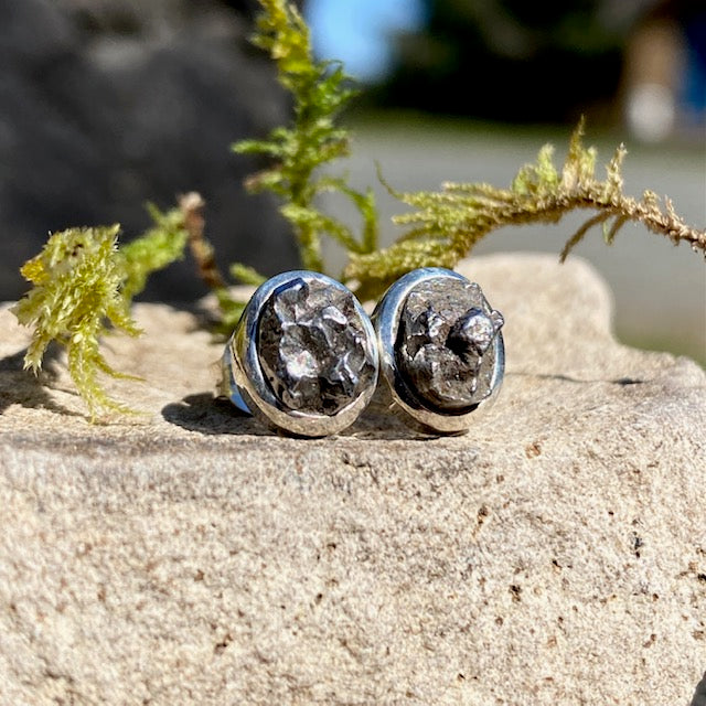 These genuine meteorite Campo del Cielo & silver stud earrings are literally, out of this world. We ship from British Columbia, Canada. See Crystal Cabin's full selection of meteorite jewelry.