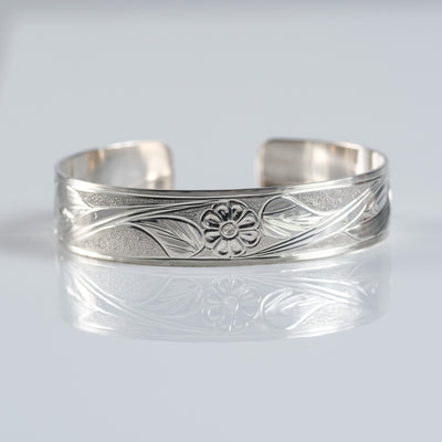 Sterling Silver Haida Canadian Indigenous Hummingbird with Flower Cuff Bracelet by Haida tattoo artist Gregory Williams sold by Crystal Cabin