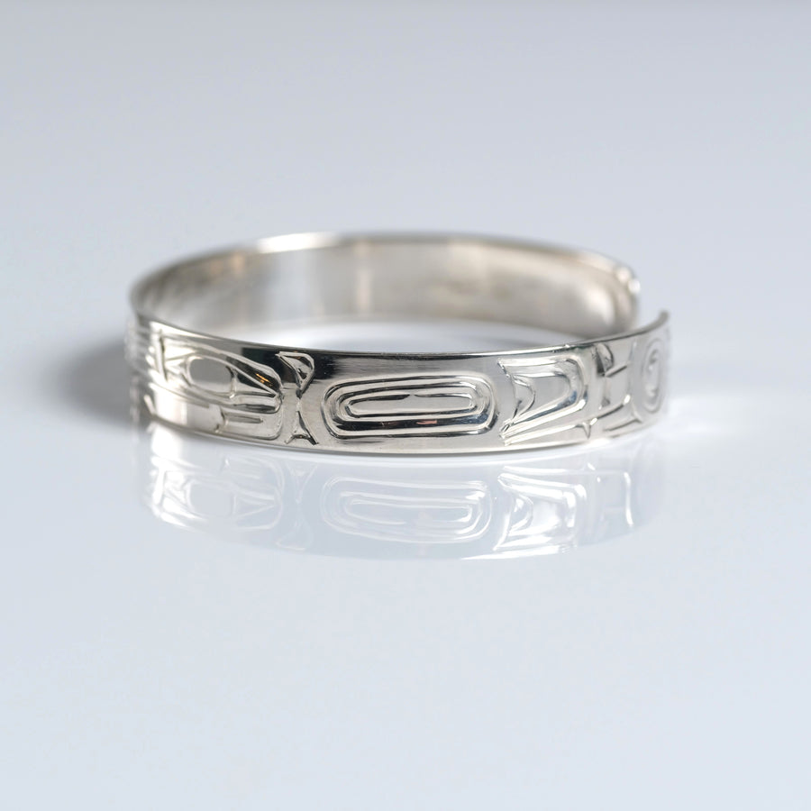 Sterling silver hand-carved Haida 1/4 inch narrow eagle & raven cuff bracelet from Crystal Cabin is by Haida Indigenous Canadian artist Garner Moody from Haida Gwaii.