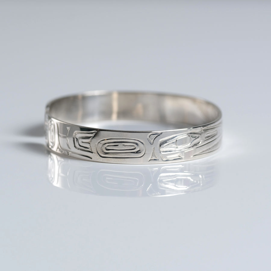 Sterling silver hand-carved Haida 1/4 inch narrow hummingbird cuff bracelet from Crystal Cabin is by Haida Indigenous Canadian artist Garner Moody