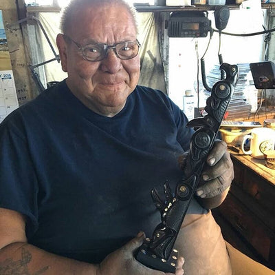 Haida carver Myles Edgars with argillite totem pole