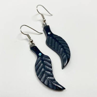 These Argillite Feather Earrings with abalone paua shell are handmade by Haida Indigenous Aboriginal First Nations artist & carver Amy Edgars from Haida Gwaii, Canada and sold by Crystal Cabin.