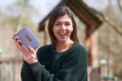 Mom proudly holding a white striped First Aid Kit