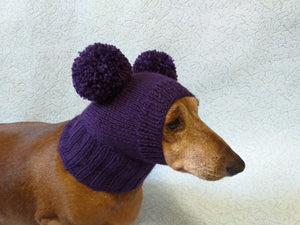 Knitted purple hat for dog with two pompons