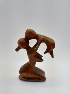 Wooden abstract figurine mom with a baby