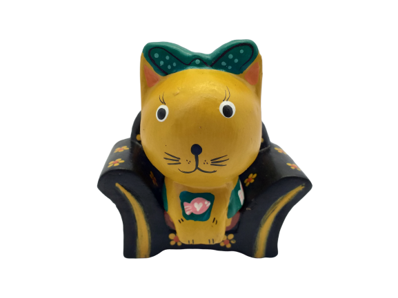 Wooden cat figurine in a chair