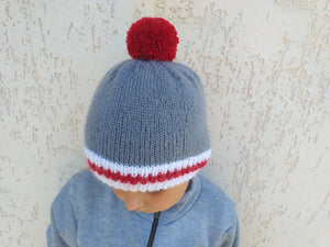 Gray knitted women's hat with pompom