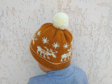 Christmas hat with reindeer and snowflakes and big pompom