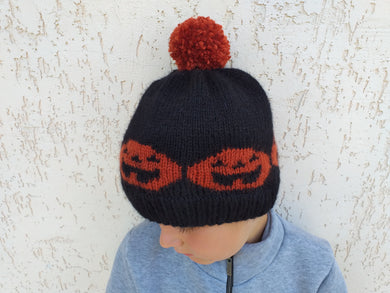 Knitted halloween hat with pumpkin and pompom