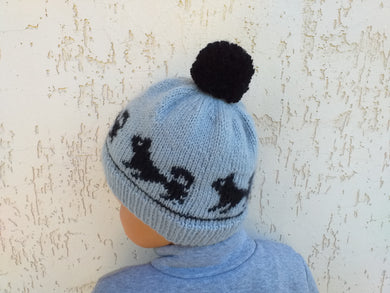 Knitted dog hat with pompom, women's hat with dogs with pompom
