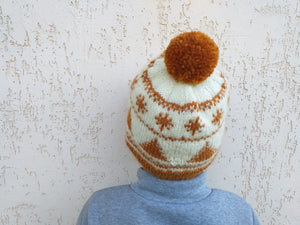 Christmas golden hat with Christmas snowballs and a big pompon