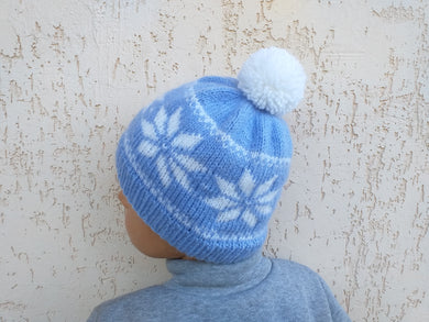 Christmas knitted hat with snowflakes and pompom for woman