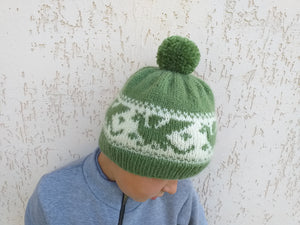 Knitted hat dragons for woman with pompom
