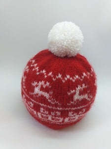 Christmas red hat with gifts reindeer and pompom