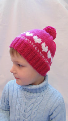 Winter knitted hat with hearts for girl 4-7 years old