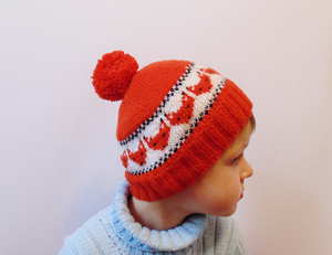 Knitted hat fox cap is made for a boy of 4-7 years