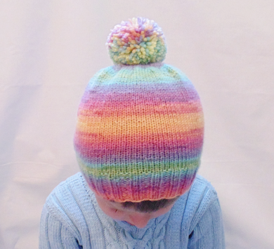 Multi-colored children's hat 4-7 years old with pompom