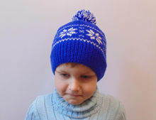 Load image into Gallery viewer, Hat with snowflakes and pompon boy cap is made for a boy of 4-7 years