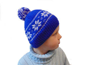 Hat with snowflakes and pompon boy cap is made for a boy of 4-7 years