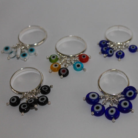 Evil Eyes Rings shown in all colors