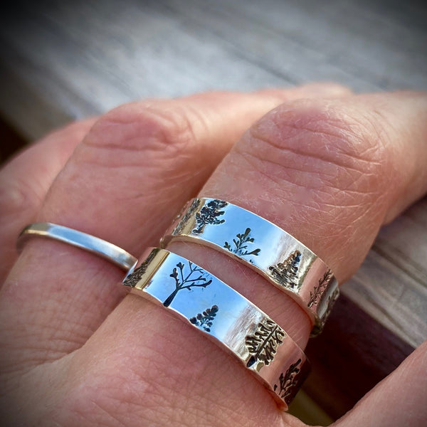 Two Trees Rings shown together on one finger