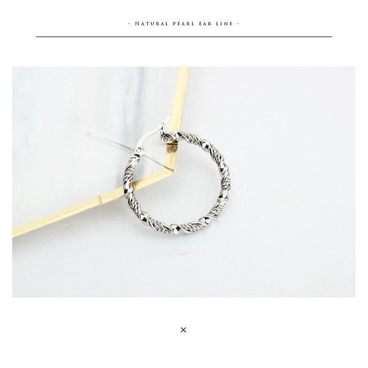"""TWISTED HOOP"" EARRING"