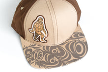 Load image into Gallery viewer, Sasquatch Snapback Hat by Francis Horne Sr., Coast Salish