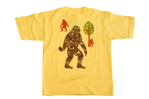 Yellow children's t shirt featuring brown sasquatch in the middle with two smaller ones and a tree in the background