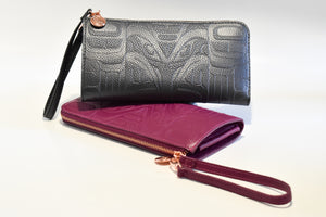 Black and light purple polyurethane wallets with native print embossed on both sides.