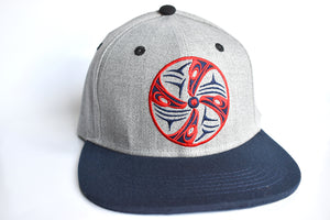 Transformation Snapback Hat by artist Dylan Thomas (Lyackson)