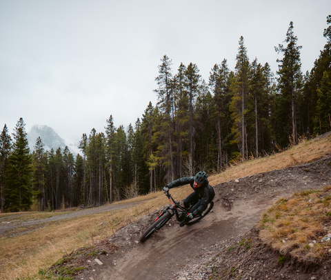 Endurance athlete mountain biking in Canmore Alberta Canada fuelled by vegan food products